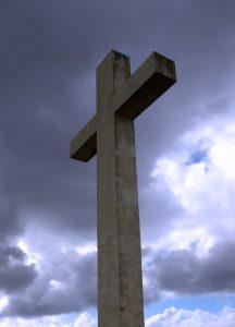Cross against cloudy sky